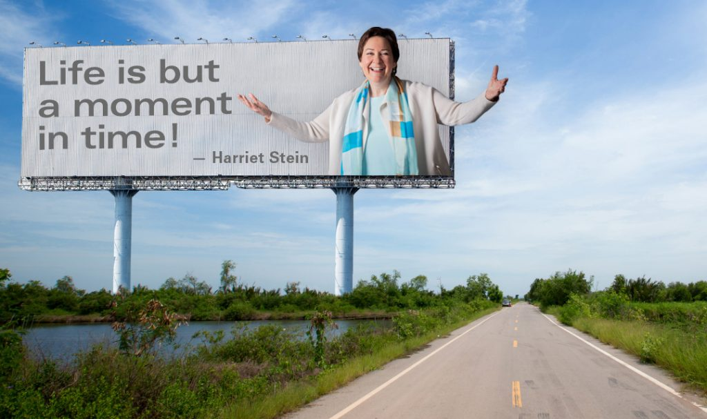 """Harriet on a billboard that says """"Life is but a moment in time!"""""""
